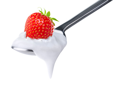Spoon of strawberry yoghurt isolated on white