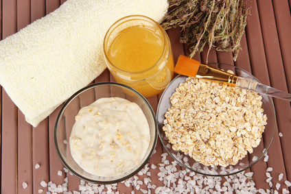 Homemade facial mask with oats and honey,on color wooden