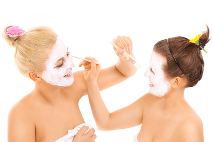 Friends applying facial masks