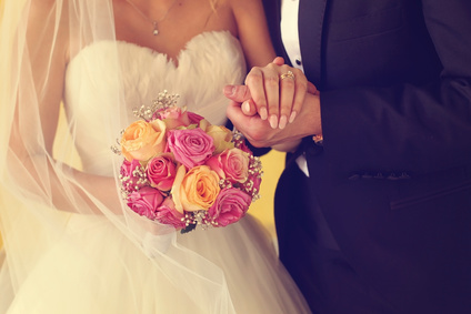 bride and groom holding hands and wedding bouquet